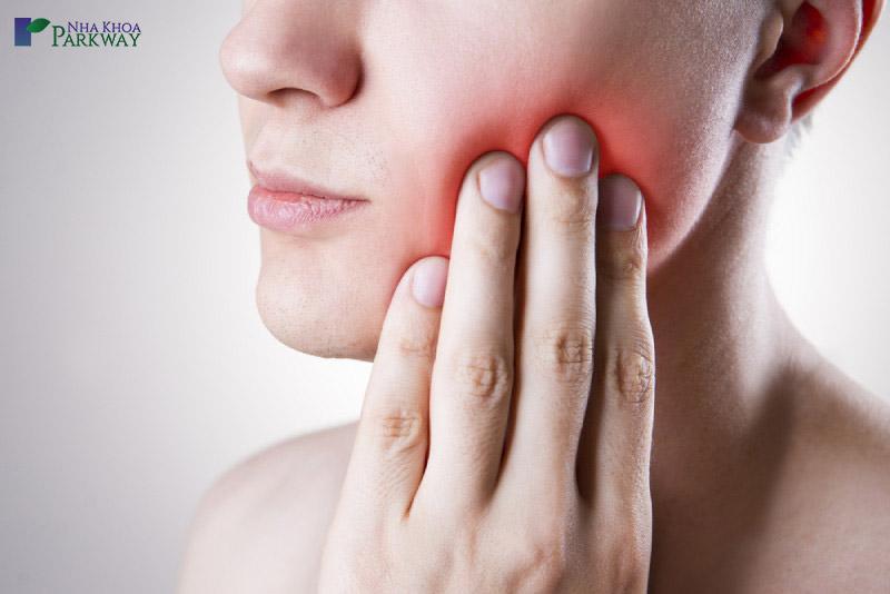 nhổ răng khôn làm thế nào cho hết đau